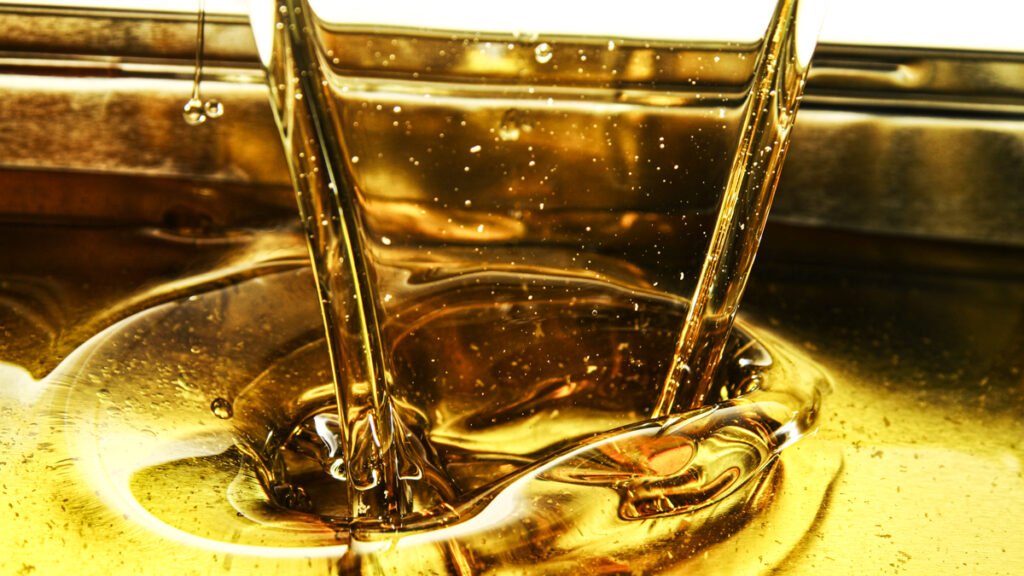 Pour cooking oil into container